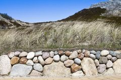 Sylt Green planted Stonewall in front of dunes Stock Photos