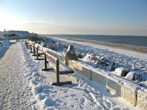 Sylt winter benches. Benches and beach under heavy snow on famous Sylt island, Germany Stock Photography