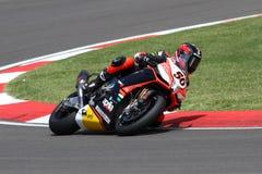 Sylvain Guintoli #50 sulla fabbrica 1000 di Aprilia RSV4 con Aprilia che corre Team Superbike WSBK Fotografia Stock