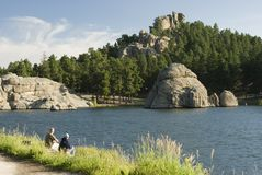 Sylvan Lake 2. A couple fishing at Sylvan Lake in the Black Hills of South Dakota. Summer 2007 Stock Image