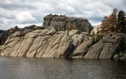 Sylvan lake in black hills of south dakota. Black Hills of South Dakota eroded granite pillars, towers, and spires on Sylvan Lake on a cloudy day Stock Photography