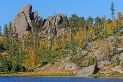 Sylvan Lake shoreline, Custer Park. Sylvan Lake shoreline and rocks in Custer State Park, South Dakota, during the fall royalty free stock photo