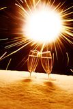 Sylvester. Two champagne glasses in snow clink glasses for new year on sylvester firework in backgroung stock image
