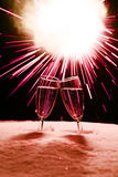 Sylvester. Two champagne glasses in snow clink glasses for new year on sylvester firework in backgroung Stock Photography