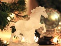 Sylvesterabende Feierhintergrund mit Pferd Stockfoto