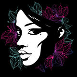 Sylwetka żeńska twarz dekorował z kwiatami Obrazy Stock