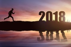 Sylwetka biznesmena dojechania działający cel 2018 Obrazy Stock
