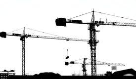 Sylwetka dźwigowy pracujący budynek Zdjęcia Stock