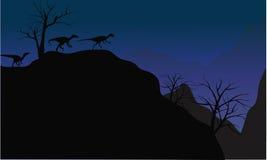Sylwetka eoraptor w falezie Fotografia Stock
