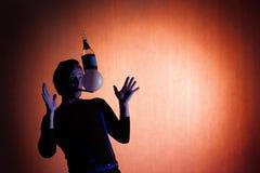 Sylwetka juggler Fotografia Royalty Free