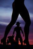 Sylwetka kobiet nóg bocznego ciała kształt z kowbojem Obrazy Royalty Free
