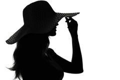 Sylwetka kobieta w kapeluszu Zdjęcie Stock