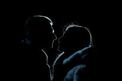 Sylwetka kochankowie, mężczyzna i kobiety w wieczór, Obraz Stock