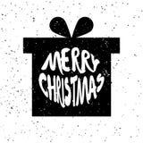 Sylwetka nowego roku ` s prezent z literowanie teksta Wesoło bożymi narodzeniami na białym tle z pluśnięciami Fotografia Stock