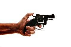 Sylwetka a obsługuje rękę z pistolecikiem Zdjęcie Royalty Free