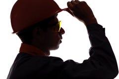 Sylwetka profil mężczyzna twarzy budowy inżynier w hełmie Zdjęcia Stock