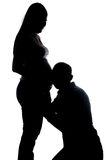 Sylwetka słuchający męża i żony brzuch Fotografia Royalty Free