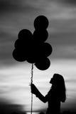 Sylwetki balonowa dziewczyna Fotografia Royalty Free