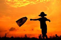 Sylwetki chłopiec Azjatycki połów Fotografia Stock