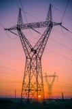 Sylwetki elektryczności pilony Fotografia Royalty Free