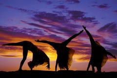 Sylwetki kobiety cartwheel serie Obrazy Royalty Free