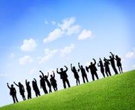 Sylwetki ludzie biznesu z rękami Podnosić Zdjęcia Royalty Free