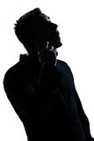 Sylwetki mężczyzna portreta telefon zaskakujący Obraz Royalty Free