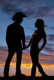 Sylwetki pary chwyt wręcza kowboja Obrazy Stock