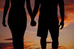 Sylwetki pary mienia ręki Zdjęcie Royalty Free