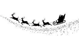 Sylwetki Święty Mikołaj latanie z rogaczem Obrazy Stock