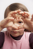 Symbol. Young girl forming a heart with her fingers stock image