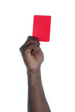 Symbol against racism. A dark-skinned human hand holding a red card as a symbol for anti-racism. All on white background Royalty Free Stock Photography