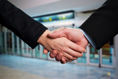 Symbol of agreement, business handshake Stock Image