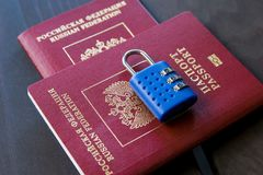 Symbol of anti-Russian sanctions. Two Russian passports locked to padlock Stock Images