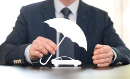 Concept of auto coverage. Symbol of auto coverage by a general agent Stock Image