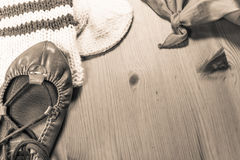 Symbol of basque holiday summer festival with scarf, abarka shoe and wool sock on wooden background in sepia Stock Photo
