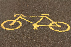 Symbol of  bike on the background of the cement. Stock Photography