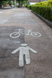Symbol of bike and walking lane on the footpath Royalty Free Stock Photos
