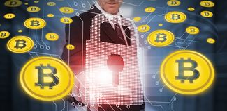 Composite image of symbol of bitcoin digital cryptocurrency. Symbol of bitcoin digital cryptocurrency against businessman touching futuristic lock and circuit stock images