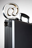 At symbol on briefcase Royalty Free Stock Photos
