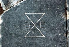 Symbol carved into granite slab, Amsterdam Stock Photos