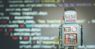 Symbol for a chatbot or social bot and algorithms, program code in the background. Robot artificial intelligence ai data big computer future internet politics stock images