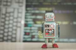 Symbol for a chatbot or social bot and algorithms, program code in the background. Robot chatbot social algorithm artificial code intelligence ai data big stock image
