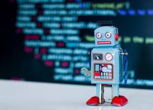 Symbol for a chatbot or social bot and algorithms, program code in the background. Robot artificial intelligence ai data big computer future internet politics stock image