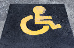 Symbol of Child wheel chair in parking lot. Yellow Symbol of Child wheel chair in parking lot Stock Images