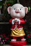Year of the pig, Chinese New year 2019 lantern outdoor happy figure. Symbol of the Chinese zodiac New year 2019 a happy pig figure in a bed of flowers stock photography