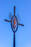 Symbol of Christianity cross on sky background. Lourdes, France Stock Photo