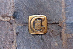Symbol of the city of Grasse mounted in the paving blocks Royalty Free Stock Image