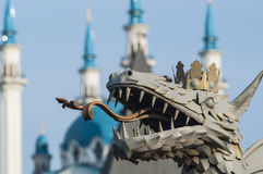 A symbol of the city of Kazan. Dragon, a symbol of the city of Kazan Kremlin on background Stock Images