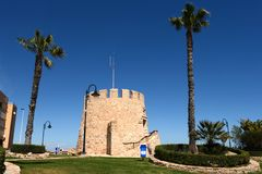 Symbol of the city Torrevieja  - the old tower. Spain. TORREVIEJA, SPAIN - APRIL 4, 2014: Torrevieja is a Mediterranean city, with a privileged location and Royalty Free Stock Photography